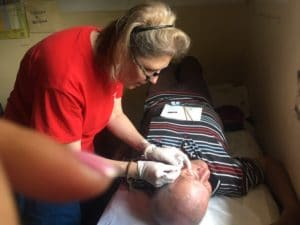 Photo of Mellissa Binney examining a patient in Honduras.
