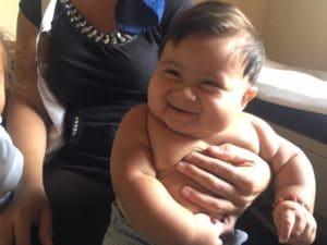 Photo of a Honduran baby smiling.